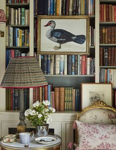 The designer Penny Morrison's magical Welsh home A watercolor of a duck by eighteenth-century British artist Peter Paillou fronts the bookshelves in the library. The brass lamp on a side table has a custom-made shade from Penny Morrison Accessories. Welsh Country, Country Style, Box Wood Shrub, Armchair Slipcover, Home Libraries, Sit Back And Relax, Floral Rug, Cool Ideas, Formal Living Rooms