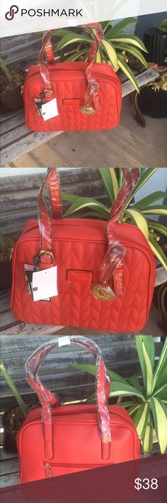 """Quilted satchel with charm by Christian Lacroix ❤️ This quilted satchel adds texture to your look. Spacious interior features pocket storage to help you stay organized. A removable handbag charm offers a trendy touch. 10.5"""" L by 13"""" W by 6"""" D. 7.5"""" handle drop. Interior: 1 zipper pocket, 2 slip pockets. Exterior: 1 super pocket. Bonus handbag charm included. Made in USA 🇺🇸 Christian Lacroix Bags Satchels"""