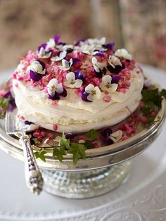 Pavlova with edible flowers.