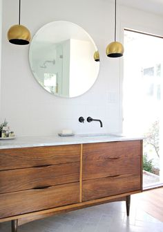 A Blah Bathroom Gets a Marvelously Modern Makeover | Martha Stewart Living - Interior Designer Kirsten Grove takes us on a tour of a beautiful bathroom transformation in a 1960s ranch-style home.