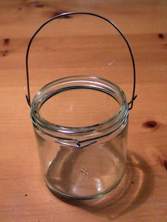 Looking forward to decorating a new house! Glass candle jars for the back yard Jar Lanterns, Hanging Lanterns, Diy Hanging, Wedding Lanterns, Mason Jar Gifts, Mason Jar Diy, Glass Candle, Candle Jars, Hanging Mason Jar Lights