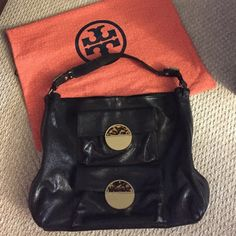 Last price drop! Authentic !! EUC Tory Burch bag!! Ladies, this bag is magnificent! Authentic Tory Burch Black Leather Double Pocket Tortoise Tote Bag. This bag is very RARE. EUC. Large bag as you can see in pic # 4. Two pockets in the front and an interior zipper pocket, along with cell phone pocket. Gold hardware. Surface scratches on the hardware due to regular use for a while. I loved this bag!! The leather is kind of a shimmery black. It's just sooo beautiful! Don't hesitate to ask for…