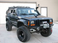 I'd ike this low profile safari rack and light bar for my Cherokee I like the winch and bumper!