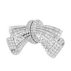"""Diamond Bow Double Clip-Brooch -  Platinum, the stylized bow topped by three ribbons set with 124 baguette diamonds, the scrolled ribbons set with 143 old-mine cut diamonds, totaling approximately 15.25 cts., circa 1935, approximately 23.3 dwt. 1 3/16 x 2 1/2"""""""