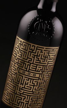We translated the story into labels by choosing to reveal the wine's mystery only in a special light. We decided that a labyrinth themed pattern would be the perfect place to hide a secret and choosing gold foil would give the label a great texture in low-key illuminated places. Furthermore, we crafted a typeface that would blend seamlessly into the label's labyrinth and silk screened with ultraviolet ink the wine's name.