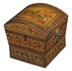 A REGENCY PENWORK SEWING BOX - Decorated overall with bands of foliage, the hinged domed lid depicting a boy in a landscape, enclosing a paper-lined interior, above a divided drawer, with lion's-mask ring handles above paterae - 6¾ in. (17 cm.) high; 7 in. (18 cm.) wide; 6½ in. (16.5 cm.) deep