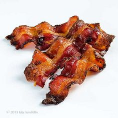 Candied bacon. So good and and so quick and easy.  Just made this to go with bacon-y, onion-y, cabbage-y cheese noodles.  OMG. Yum doesn't even begin to sum this recipe up. Before baking I sprinkled my candied bacon with just a little cayenne pepper for a touch of heat. Delicious!