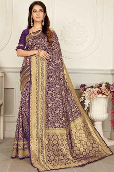 Purple banarasi silk saree with purple silk blouse. Embellished with Woven zari work. Saree with Round Neck, Half Sleeve. It comes with unstitch blouse, it can be stitched to 32 to 58 sizes. #purple #banarasi silk #saree #blouse #Indiansaree #Andaazfashion #UK