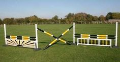 a row of three jumps using four standards. This would be good to have different heights of warm-up fences so you don't have to get off every time you're ready to raise.