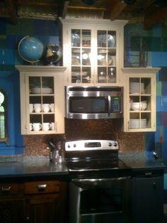 Kitchen backsplash tiled with pennies