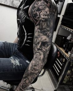 Black and grey ink classical sleeve by Shun Tattoo