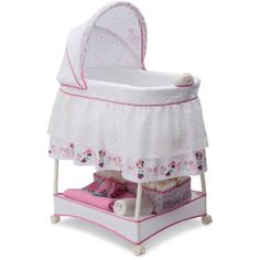 Make your girl's space extra-special with a little help from Mickey's main squeeze, Minnie Mouse! The Minnie Boutique Gliding Bassinet by Delta Children . Nursery Furniture, Nursery Bedding, Bed Furniture, Minnie Boutique, Bedside Bassinet, Hanging Bassinet, Wood Bassinet, Bassinet Cover, Bedside Sleeper
