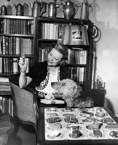Grethe Weiser, (German Actress) with collection of snuff boxes and her Airedale. c.1950