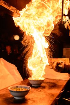 Fire Ramen: Men-Baka Ramen Restaurant (めん馬鹿) -- Kyoto, Japan: Scalding oil is added to a bowl of noodles and green onions before it's set on fire. Image credit Jeffrey Friedl #Ramen #Flaming
