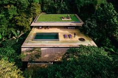 Set on a mountainside overlooking the Atlantic Ocean, the Rainforest House manages to blend into the surroundings despite it monolithic, rectangular design. Its layout is the reverse of many traditional homes, with a deck, children's play area, and utilities on...