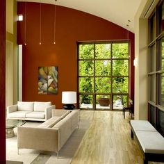 Considering painting one wall in our living room this burnt orange color...hmm...