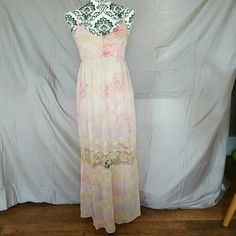 """Pink Lace Tie Dye Open Back Maxi Dress This is just such a beautiful dress! Brand new in original packaging (did not come with tags). It is a light, chiffon material in light pink and ivory tie dye. Ivory lace detailing. Lined. Elastic waist. The straps cross in the back and you can adjust them for a perfect fit. Size Medium. Price firm unless bundled!  Measurements (laying flat) Bust-17"""" Waist-14"""" (unstretched) Emma's Closet Dresses Maxi"""