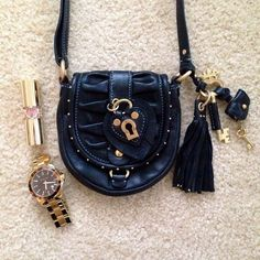 SALE! Juicy Couture Crossbody Authentic black studded leather Juicy Couture crossbody bag. Great for evening outs - big enough to fit your phone, cards, and lipstick. Flap is held together by a magnetic closure, interior has card slots and back has an open pocket for extra storage. Bag is pre-owned (small stain in the inside of the back pocket and loose thread on strap - easily fixable) but still looks great. Strap can be adjusted in height. Overall, this bag is cute and very boho chic…
