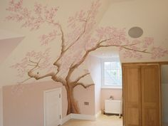 Pink cherry tree blossom painted in a bedroom