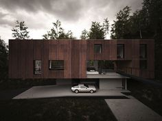 Hyde Architects designed House for a Photographer, a modern, elevated home located at the bottom of a former quarry in South Wales' Brecon National Park.