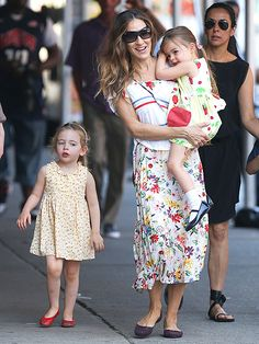 Sweltering Already Sarah Jessica Parker and twin daughters Marion and Tabitha walked through summer-like temperatures in NYC May 30.