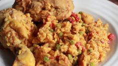 """In a Cuban home, nothing is more comforting than a big plate of """"Arroz con Pollo"""". I can recall, after a long day at high school and soccer practice, devouring more than a plate full. The savor aroma that fills your home while you cook this meal is almost as comforting as the meal itself.  Every Cuban family has their special Arroz con Pollo recipe, having a preference on how soupy the end results looks like, but this basic recipe is the foundation.  Make Arroz con Pollo for a family…"""