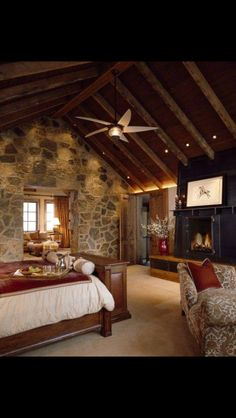 very nice... except for television over fireplace... maybe in cabinet at foot of bed??