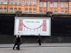 Advertisers battle vandals - damaged billboard replaced