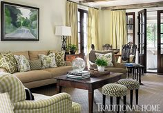 Colorful, Kid-Friendly Atlanta Home | Traditional Home   The small stools by the coffee table makes a nice addition
