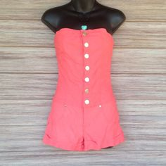 Coral Romper Super cute buttons on front. No stains or rips. Stretchy material. Body Central Other