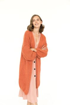 Just imagine how this soft and warm alpaca, silk and mohair sweater will feel while walking your pet on the beach. We promise it will make this casual yet special activity even more enjoyable!This long mohair cardigan was created to perfectly blend into your lifestyle and match your wardrobe with elegance and style. From classic office attire to create professional look to a casual everyday look, it will instantly enhance your favourite combinations of clothing. Orange Cardigan, Orange Sweaters, Long Cardigan, Knit Cardigan, Mohair Sweater, Sweater Coats, Cable Knit Sweaters, Women's Sweaters, Cardigans
