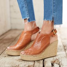 Made for each other: destructed step hem denim and a dressed-up wedge espadrille. Opposites always attract.