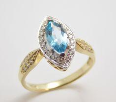 prsteň zo žltého a bieleho 14 kt zlata s topázom a diamantami