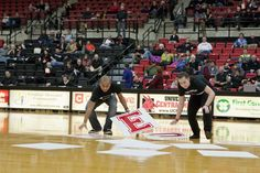 Students competing in the Choose Red Shuffle game at #TeamUCM night at the Blackout Game