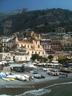 Positano, notice the dome of the main church in Positano, it's covered with the typical majolica tiles; Positano, costa Amalfitana. www.linguacultura.be