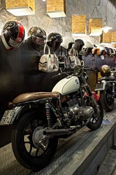 combustible-contraptions:  Another View …. Apartment, Lounge, Shop? | An Enthusiast's Haven Helmet, Bubble Visor, Riding Boots and a BMW Brat | Cafe Racer | Cafe Gear | Moto Guzzi Cafe Racer