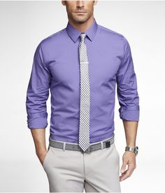 purple dress shirt, black and white tie, light grey pant, gray belt