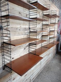 Mid-Century Modern, 1960 Extra Large Teak / Metal Tomado Shelving or Wall Unit   From a unique collection of antique and modern shelves at https://www.1stdibs.com/furniture/storage-case-pieces/shelves/