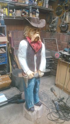 Cowboy Carving - chainsaw carved cowboy, chainsaw carved caricature wood carving