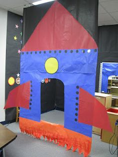 Dramatic Play (Space: A rocket ship wall with the door leading to inside the rocket. There is black paper and stars on the walls to represent outer space). Space Preschool, Space Activities, Preschool Activities, Preschool Centers, Dramatic Play Area, Dramatic Play Centers, Space Classroom, Classroom Themes, Outer Space Theme