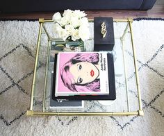 small shop for Adore Home photo by Sabra Lattos living room coffee table Jonathan Adler beni ourain rug