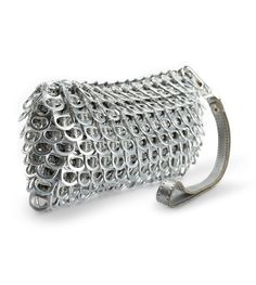"Puff metallic wristlet. Expandable textured shell is supple and smooth to the touch. Zip closure. Silver sateen fabric lined interior. Detachable wrist strap. Size: 7"" L x 3.5"" H x 1"" D Thread color:"