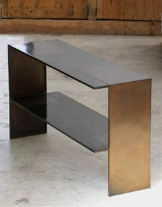 Eric Schmitt - Cut-In (2005) Bronze with black and brown patina. Console table.