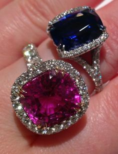 Detail: Cocktail rings by Omi Privé: a blue sapphire, platinum, and diamond ring and a pink sapphire, rose gold, platinum, and diamond ring. Via Diamonds in the Library.