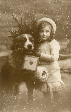 A little girl and her Saint Bernard deliver Christmas : 1910s