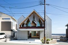 hiroto kawaguchi\'s newton house offers views of the clear blue skies as well as the blossoming cherry trees.