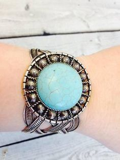CIRCLE SHAPED TURQUOISE STONE AND SILVERTONE CUFF BRACELET