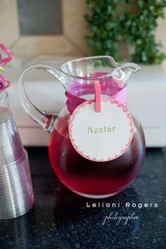 Fairy Birthday Party---Nectar (punch) in a glass pitcher with a ribbon and clothes pin to secure label...Image only