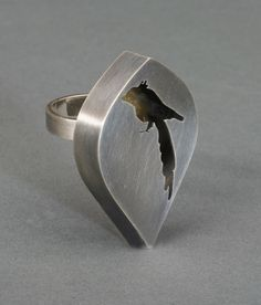 Ring   Audrey Laine.  Sterling silver and finished internally with keum-boo (gold foil) and colorful patina.