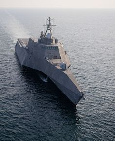 The littoral combat ship USS Independence (LCS 2) transits off the coast of Florida. Sailors from Independence's Gold Crew and embarked Mine Countermeasures (MCM), Detachment 1, are underway for the ship's maiden voyage to San Diego after completing testing on the MCM mission package.